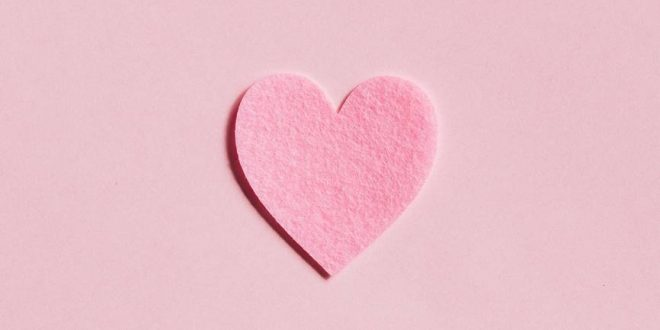 paper heart on light pink background